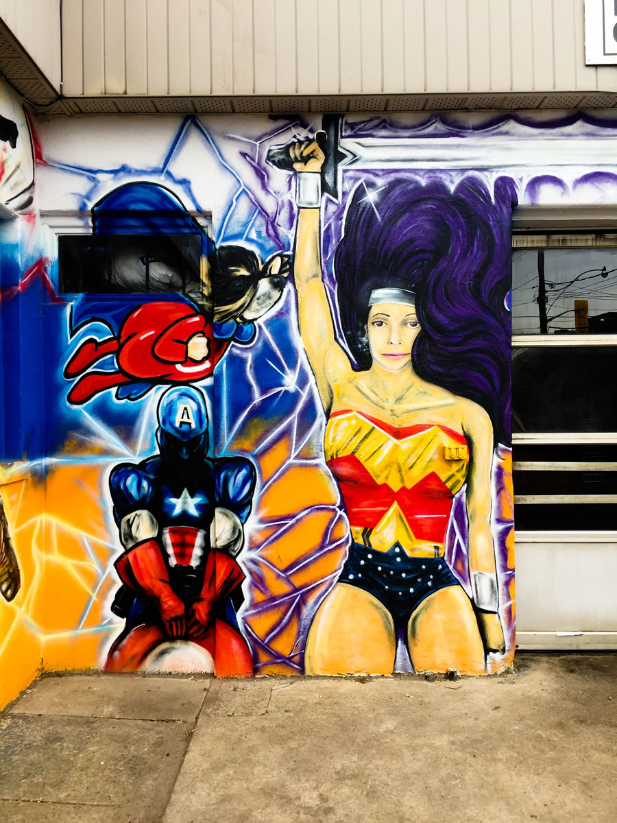 Superheroes mural at mechanic shop