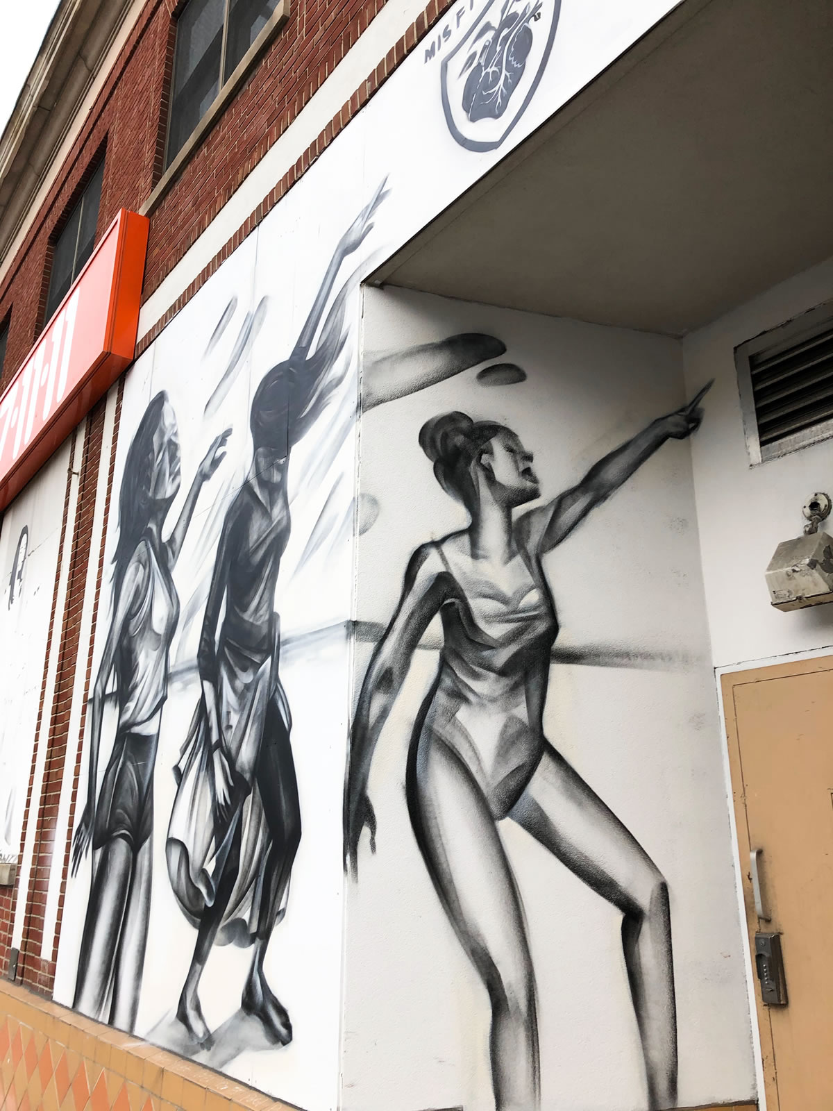 This newish mural by Elicser Elliott is outside of a pilates studio. He does a lot of storefronts lately.